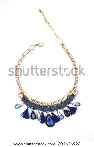 Necklace with gems and gold chain on a white background - stock photo