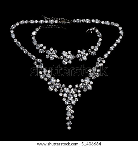 necklaces with precious stones on a black background - stock photo