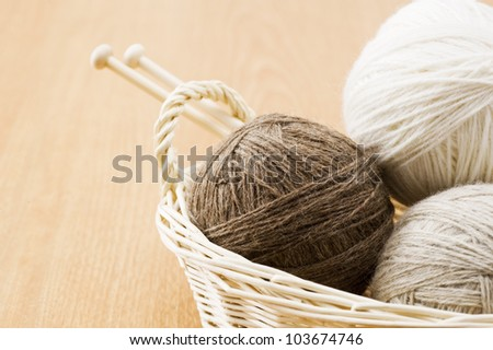 Needle and thread ball in basket - stock photo
