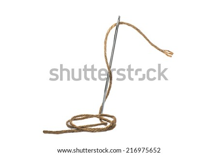 Needle and thread through - stock photo