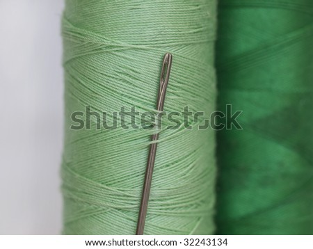 needle in green bobbin - stock photo