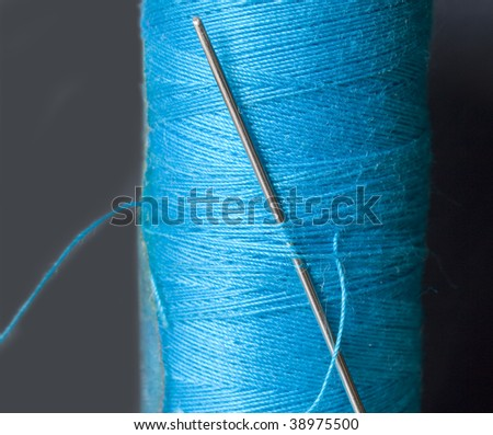 needle in the blue bobbin - stock photo