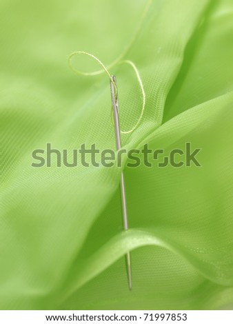 needle in the green silk - stock photo