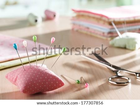 Needle pillow and scissors - stock photo