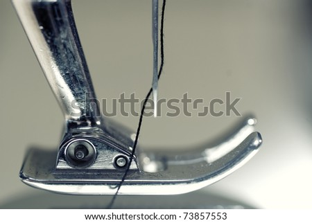 Needle plate, foot and transporter of a sewing machine - stock photo