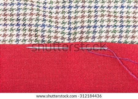 needle sews two pieces of tissue close up - stock photo