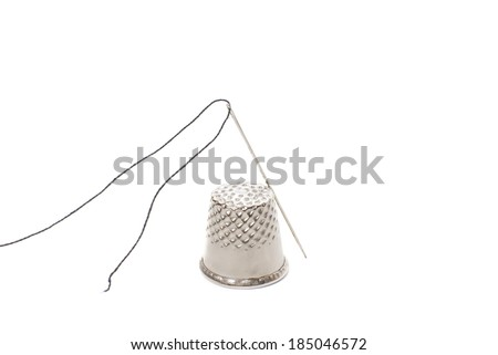 needle thread and thimble isolated on white background