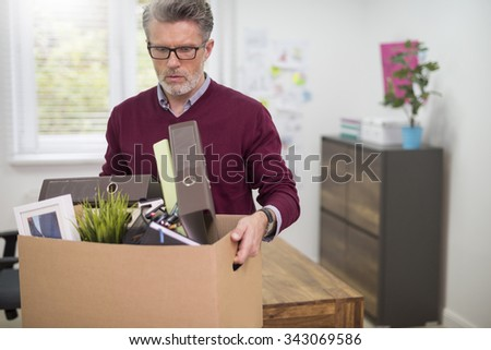 Negative emotions because of being fired - stock photo