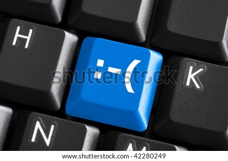 negative smilie on blue computer keyboard button showing bad feelings concept - stock photo
