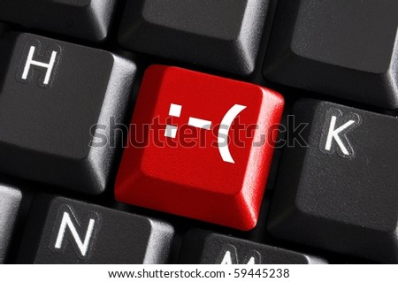 negative smilie on red computer keyboard button showing bad feelings concept - stock photo