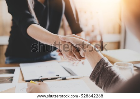 Negotiating business,Image of businesswomen Handshaking,happy with work,the woman she is enjoying with her workmate,Handshake Gesturing People Connection Deal Concept
