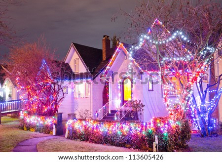 Neighborhood decorated and lighted for Christmas and for New Year Eve . Night in Vancouver, Canada. - stock photo