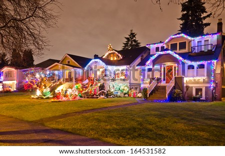 Neighborhood, houses decorated and lighted for Christmas and for New Year Eve . Night in Vancouver, Canada.
