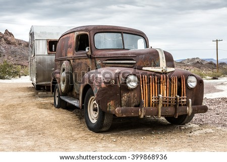 NELSON , USA - JUNE 10 : Old rusty truck and old caravan in Nelson Nevada ghost town on June 10 ,2015 - stock photo