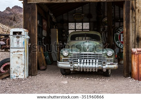 NELSON , USA - JUNE 10 : Rusty old vintage car in abandoned mechanic garage Nelson Nevada ghost town on June 10 ,2015 - stock photo
