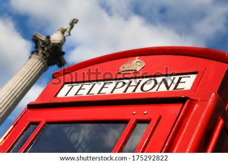 Nelsons column and Red telephone box, Trafalgar Square, Westminster, London - stock photo