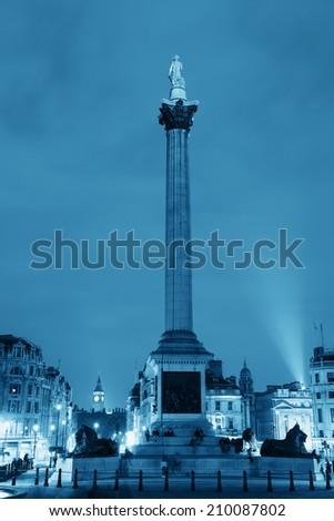 Nelsons Column in Trafalgar Square at night in London - stock photo