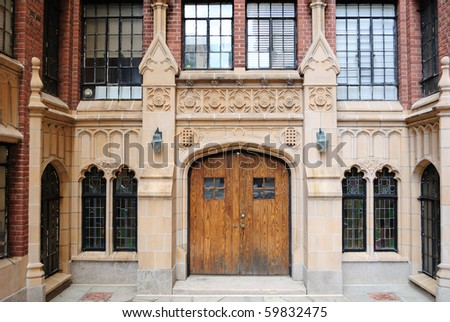 Neo Gothic style entrance to an urban apartment complex. - stock photo