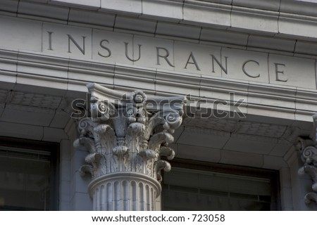 "Neoclassical architechture sports a column with the word ""INSURANCE"" above it."