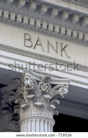"""Neoclassical architecture sports a column with the word """"BANK"""" above it. - stock photo"""