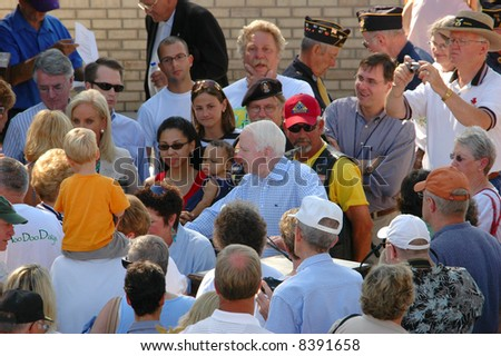 NEOLA, IA - SEPTEMBER 3: Presidential Candidate John McCain shakes hands with well wishers at Labor Day Hoo Doo Days parade September 3, 2007 in Neola, IA - stock photo