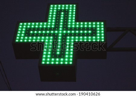 Neon green cross sign