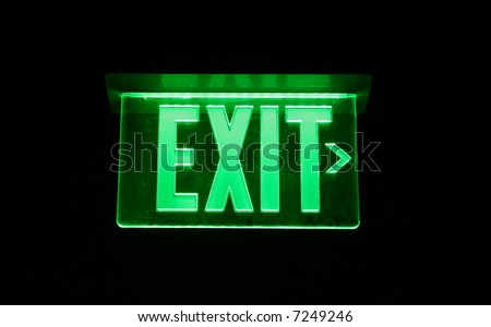Neon Green Exit Sign set on black - stock photo