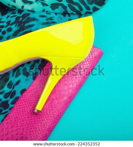 Neon high heel, dress and snakeskin print bag, woman fashion concept - stock photo