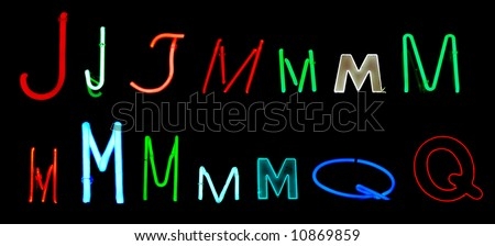 Neon letters J, M, and Q collected from neon signs for design elements - stock photo