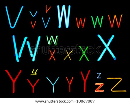 Neon letters V, W, X, Y and Z collected from neon signs for over two years - stock photo