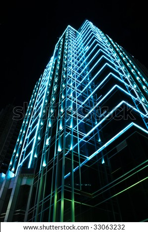 neon light decorating a mordon building - stock photo