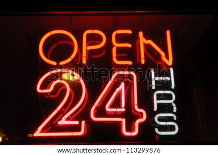 "neon shining signboard with word ""open"" night - stock photo"