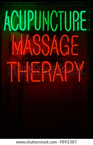 Neon sign advertising acupuncture and massage therapy - stock photo