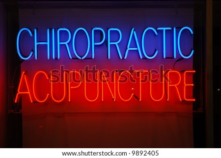 Neon sign advertising chiropractic and acupuncture services - stock photo