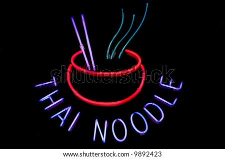 Neon sign advertising Thai noodle bowls at a restaurant - stock photo