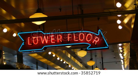 Neon sign at public market,  fresh seafood market, Pike Place Market Seattle Pacific Northwest - stock photo