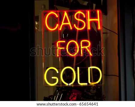 Neon sign in a pawn shop window, New York City - stock photo