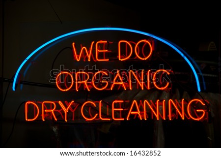Neon sign in the window of a dry cleaner in new york city - stock photo