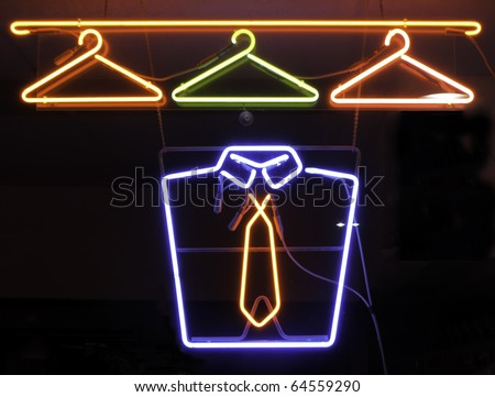 Neon sign in window of cleaners - stock photo