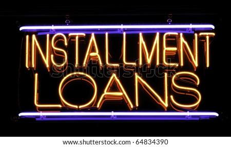 Neon sign in window of neighborhood loan shop - stock photo