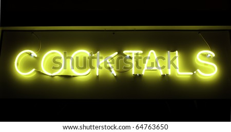 Neon sign in window of restaurant - stock photo
