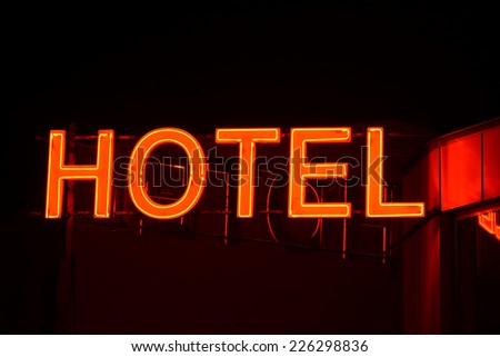 Neon sign of a small hotel. - stock photo