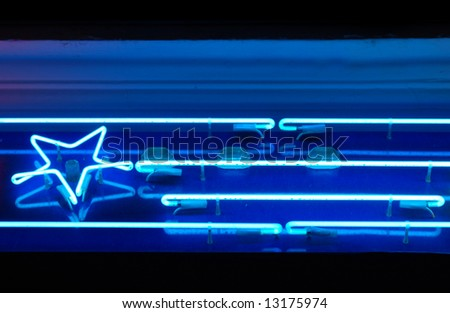 neon sign of blue star and few lines - stock photo