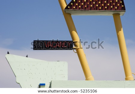 """Neon """"vacancy"""" sign on a funky old roadside motel. - stock photo"""