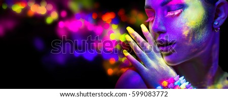 Neon Woman. Fashion model woman in neon light, portrait of beautiful model with fluorescent make-up, Art design of female disco dancer posing in UV, colorful make up. Isolated on black background.