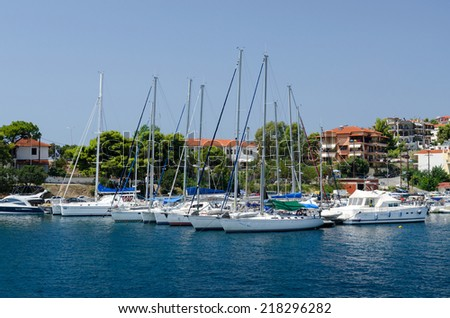NEOS MARMARAS, GREECE - AUGUST 16: Yacht at berth in August 16 in Neos Marmaras, Sithonia, Greece