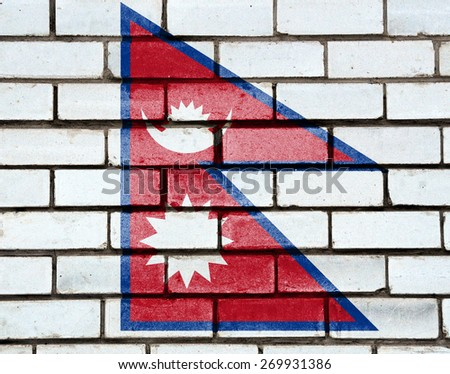 Nepal flag painted on old brick wall texture background - stock photo