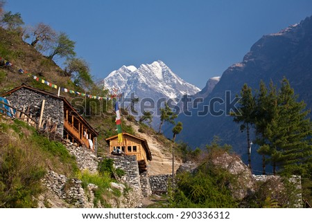 Nepal - hiking path through mountain village. Lodging - stock photo