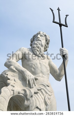 Neptune and his fork. A beautiful statue representing Neptune, aka Triton and Poseidon, and his classical trident. - stock photo