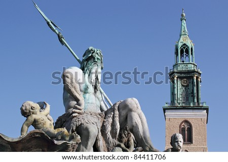 Neptune Fountain and St Mary's Church - stock photo